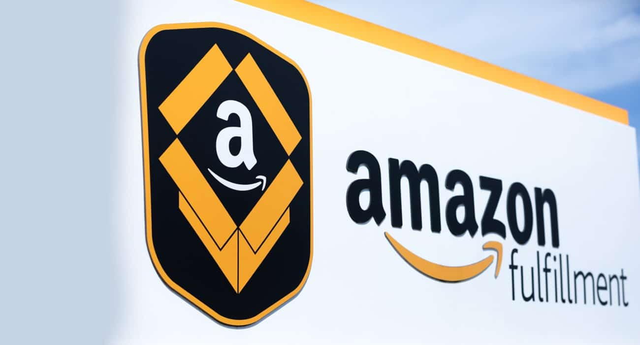 Amazon fulfillment logo, taken from a side angle. Amazon FBA logo in foreground