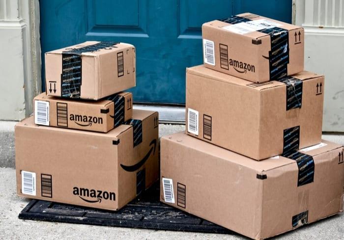 Amazon packages in front of blue door